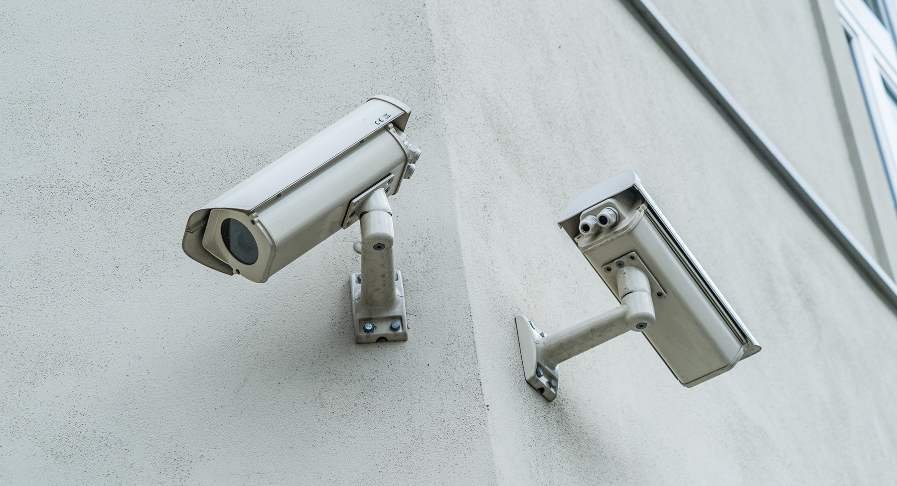 Two CCTV cameras on a wall