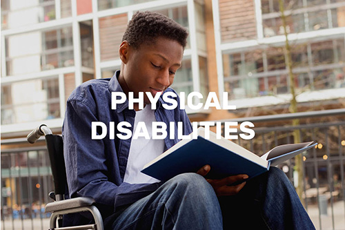 a boy in a wheelchair reading a book