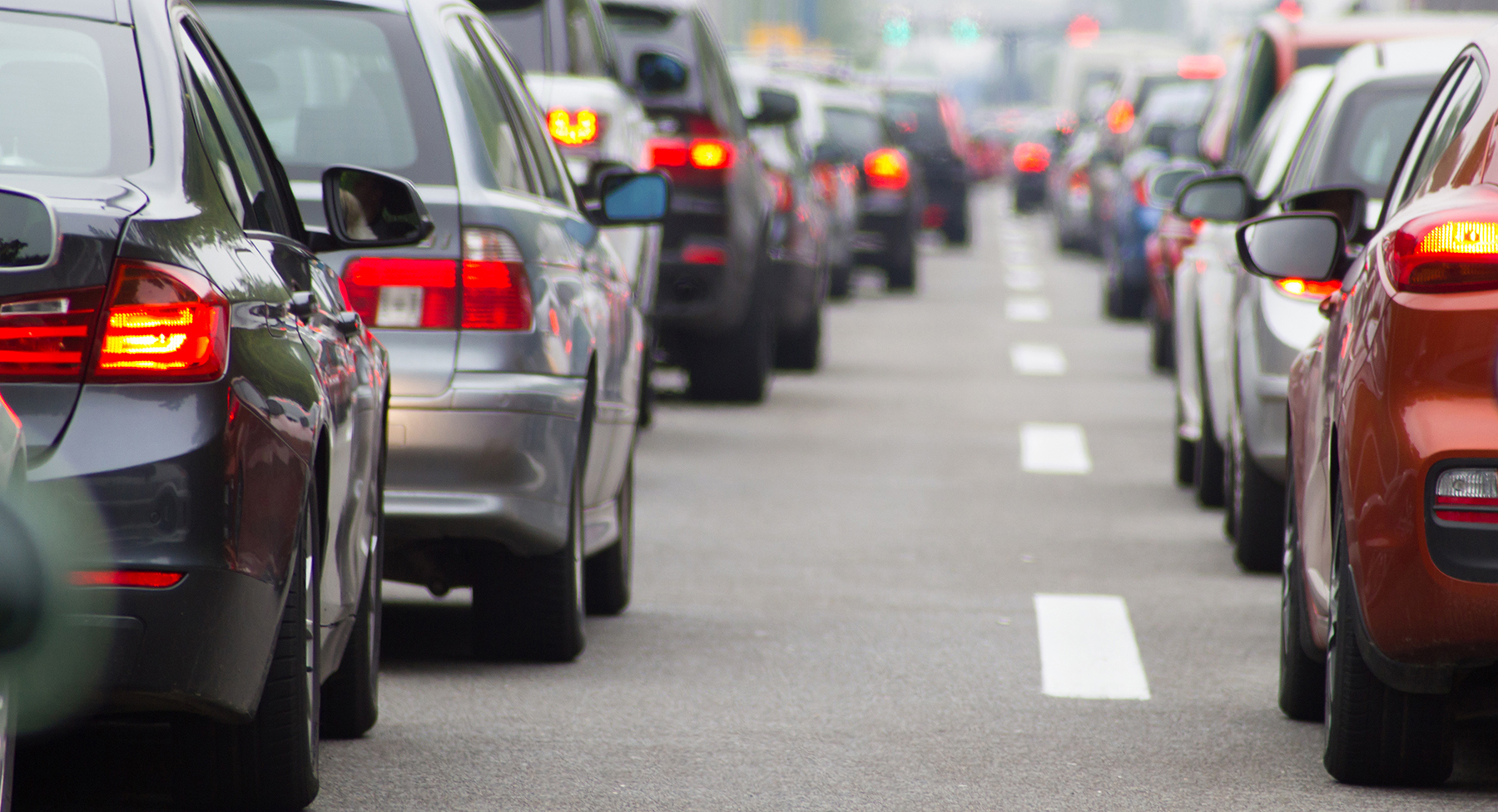 tailback of cars queuing on a motorway